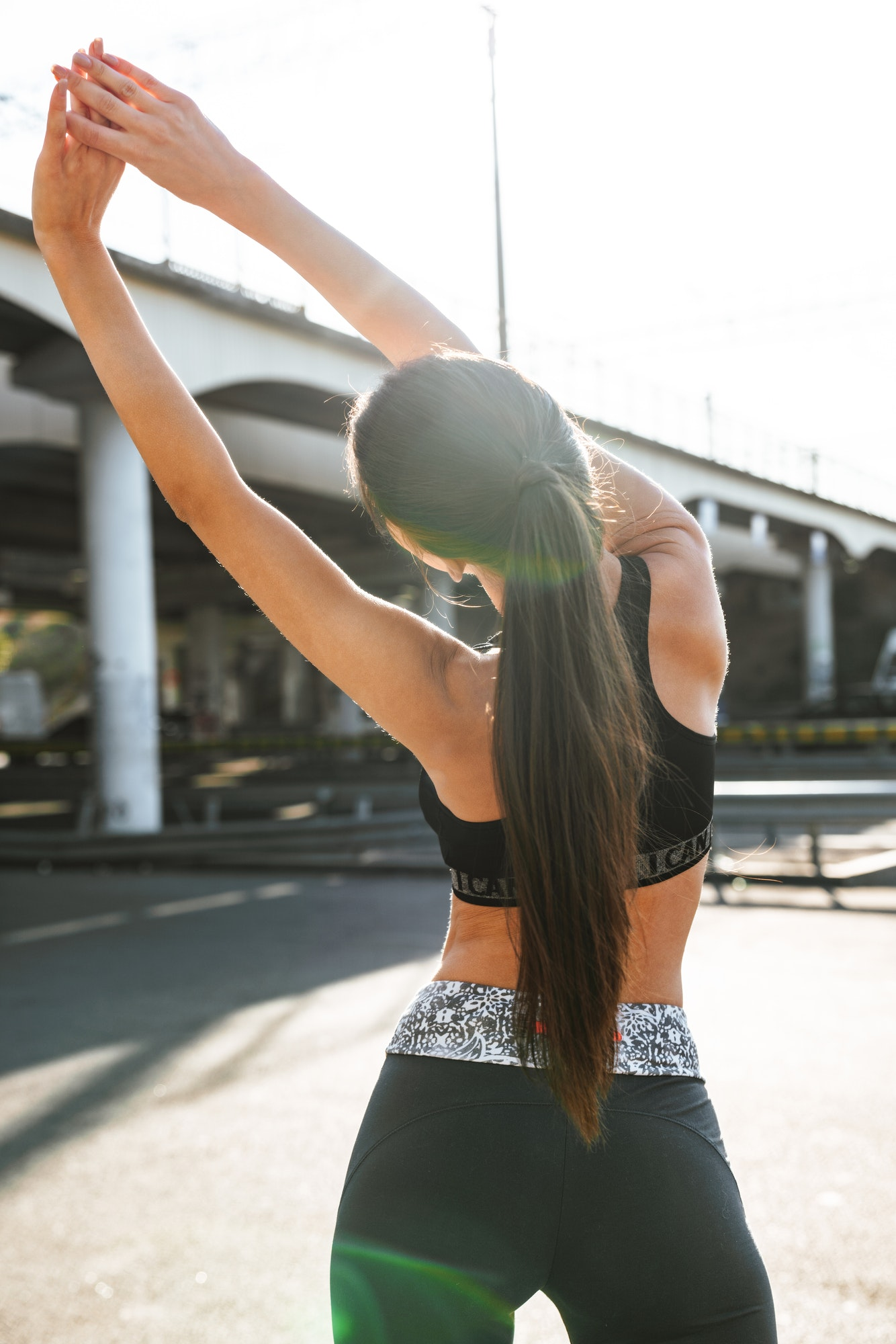 fitness-woman-make-stretching-exercises-outdoors-.jpg